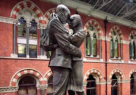 Kissing couple at St Pancras saying Goodbye