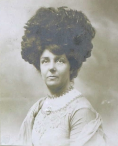 Hilda Hewlett's photograph for her pilot's licence wearing large hat