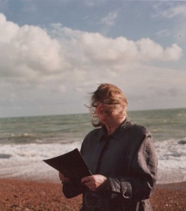 A windswept me conducting a wedding on Brighton beach for Sally and Steve who were grandparents and been together for decades.