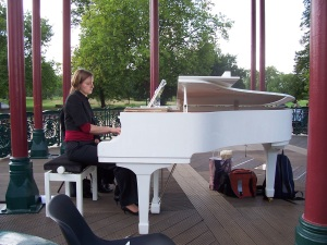 Grand piano being played at a wedding on the bandstand Clapham Common