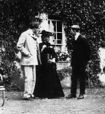 Lady Gregory with Yeats and her son Robert outside Colle
