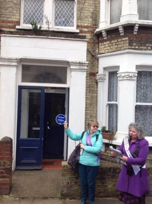 Outside 84 Lavender Sweep Lesley Strachan from Wamdsworth Radio is holding it.