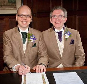 Warren Hartley and Kieran Bohan sign the Schedule of Civil Partnership at Ullet Unitarian Church in Liverpool